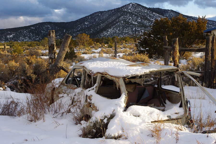 old wrecked VW in the snow in Taos
