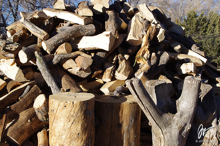 big wood pile in Taos