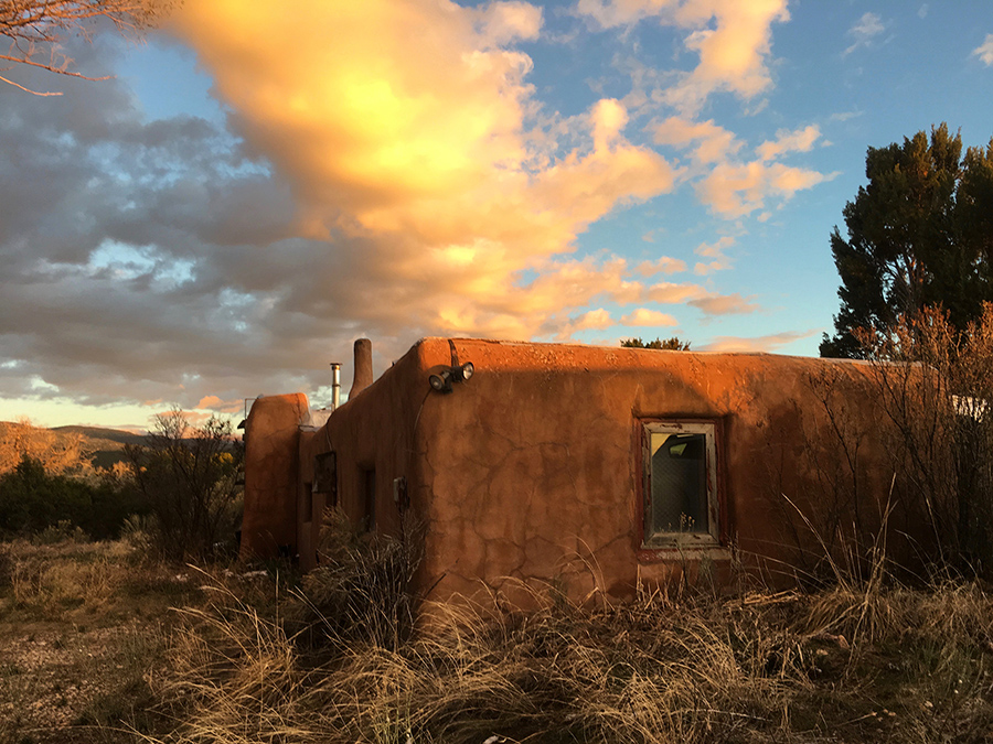adobe house at sunset in Taos, NM