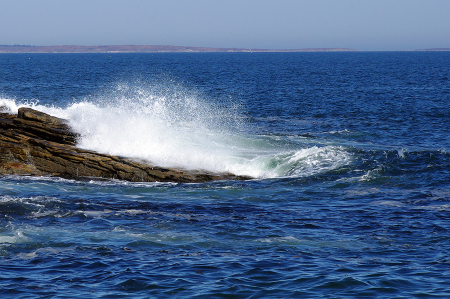 wave crashing on the rocks on the coast of Maine