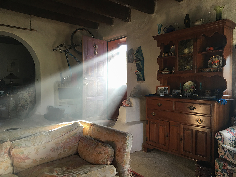 smoky light in old Taos adobe