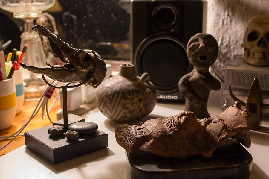 Native artifacts and sculptures on my desk