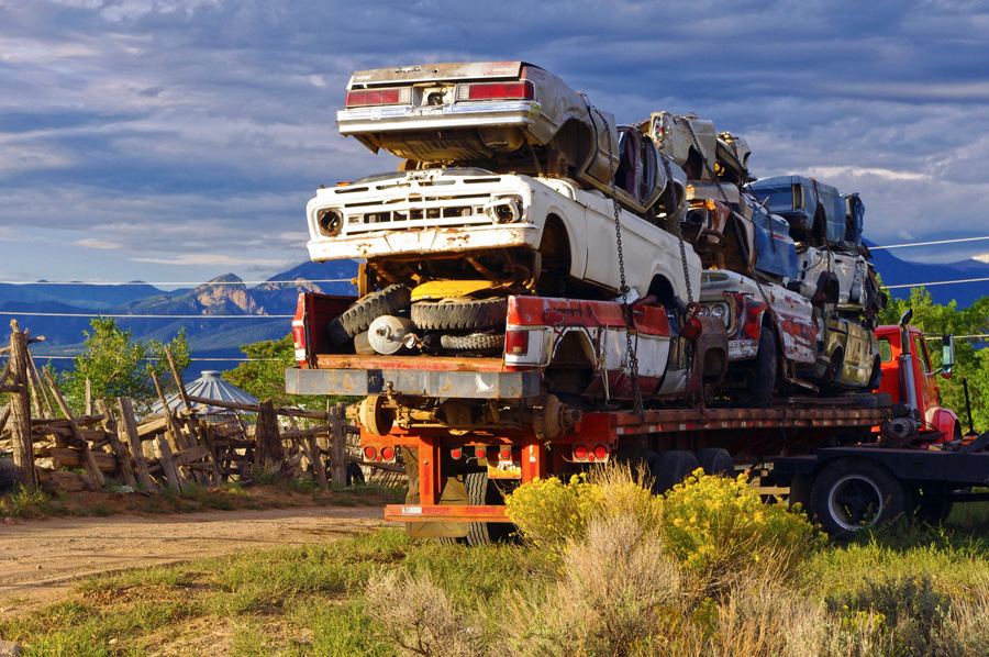 trailer of junked cars