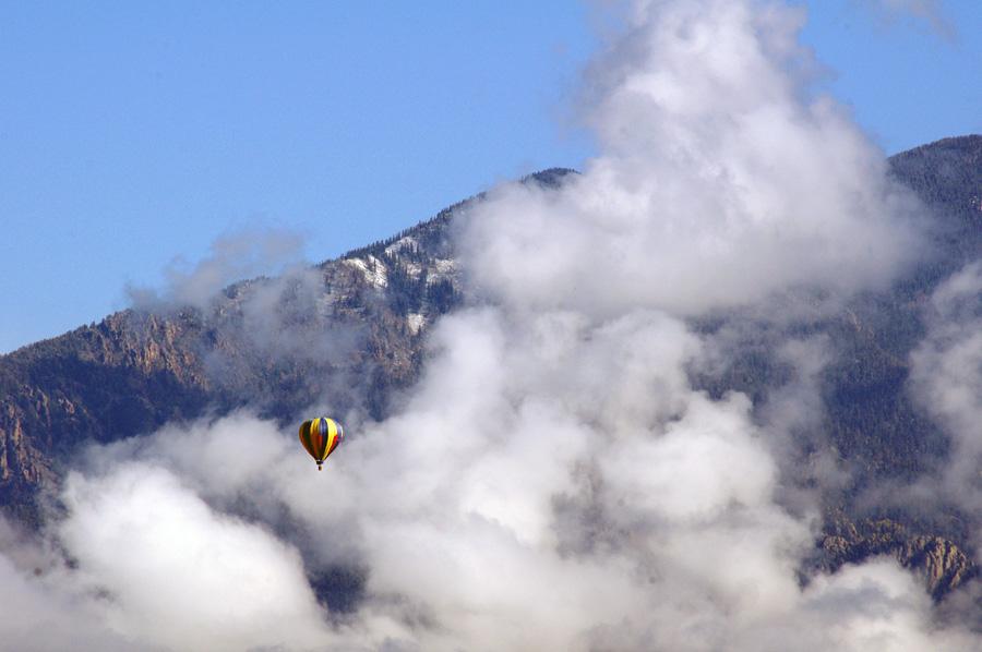 hot-air balloon passing by Taos mountain