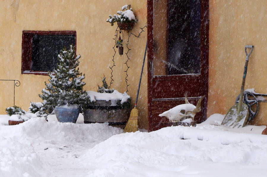 front door of an old adobe in the snow