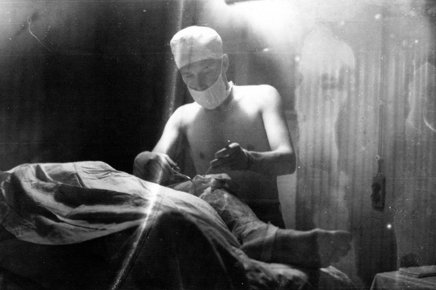 U.S. Army surgeon in operating room, WWII